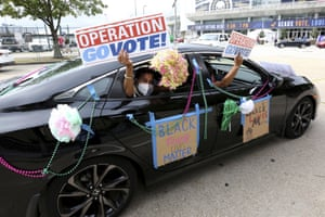 Activists drive past an early voting location at the end of a Parade to the Polls event on 3 November in New Orleans.