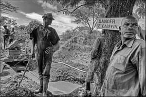 Miners pump water out of a flooded area of the Sama Fairtrade mine