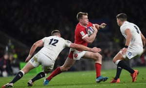 Nick Tompkins is tackled by England's Owen Farrell