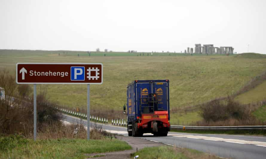 A lorry drives near Stonehenge in Wiltshire