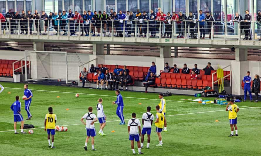 Coaches on the FA's Advanced Youth Award course watch a Chelsea Under-17s training session at St George's Park