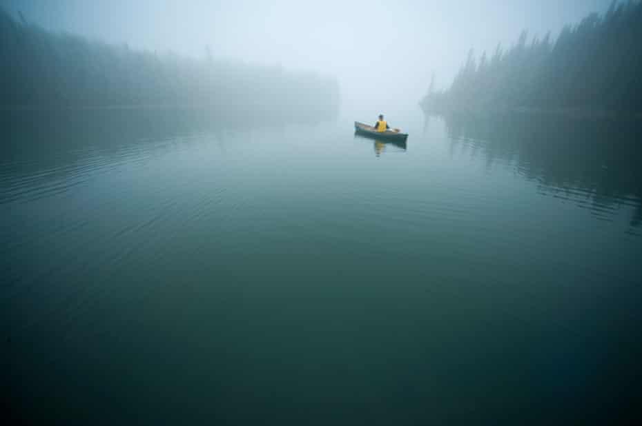 Canoeist on a lake