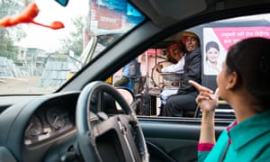 Fellow drivers at a traffic light ask 19-year-old Meenu why she's driving.