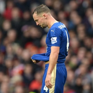 Leicester's Danny Drinkwater leaves the pitch after being sent off for two bookable offences.