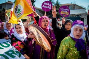 Istanbul, TurkeyPeople shout slogans as they take part in a Women's Day rally