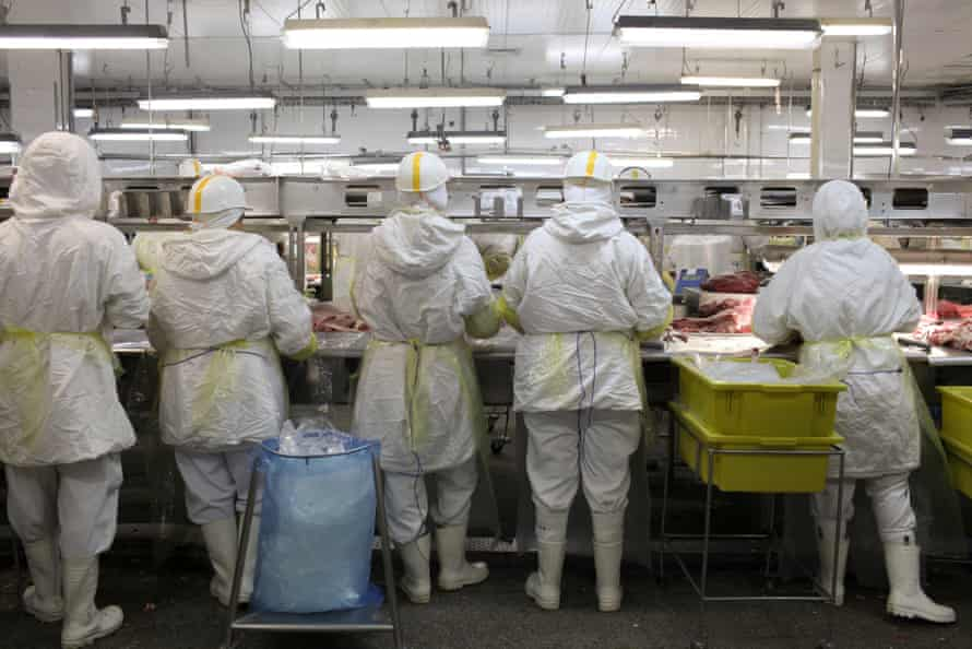 Workers process meat on a production line at the Minerva plant in Barretos.