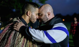 A traditional Maori 'hongi' greeting is given to a Muslim man after the Christchurch mosque massacres in April 2019.