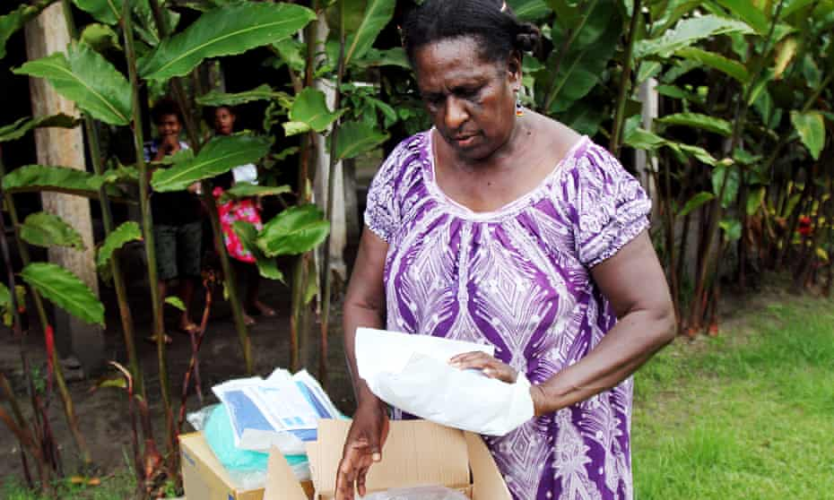 Nurse Margaret Melke receives a delivery of PPE sent to East New Britain from Papua New Guinea's National Department of Health.