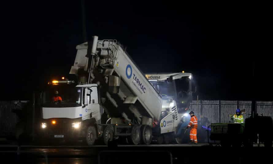Tarmac being laid last night, Tuesday December 15, 2020. Photo credit should read: Gareth Fuller/PA Wire