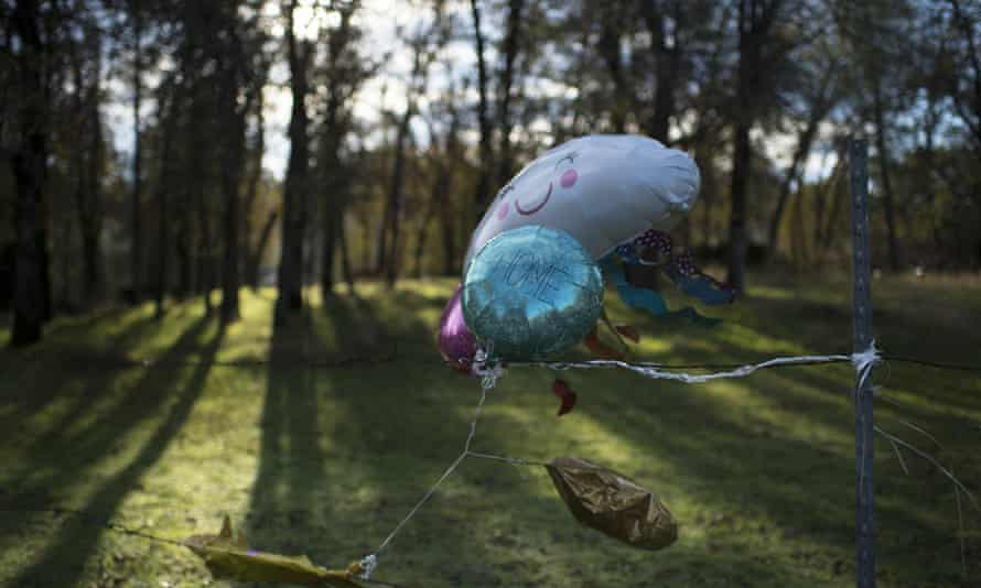 Balloons with the words 'Bring Sherri Home' are placed near the location where it is believed she went missing.