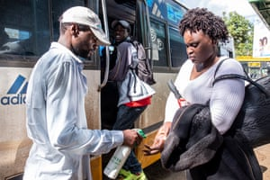 People have little choice over social distancing on the matatus but can disinfect their hands with the help of staff