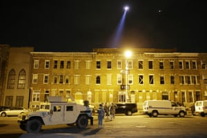 National Guard stand by during a 10 p.m. curfew in Baltimore.