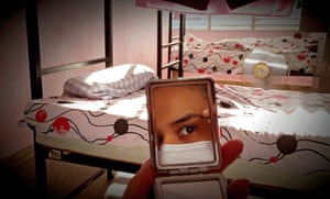 Havana, Cuba: A patient is reflected in her mirror during isolation at the Lenin vocational school for seven to 14 days