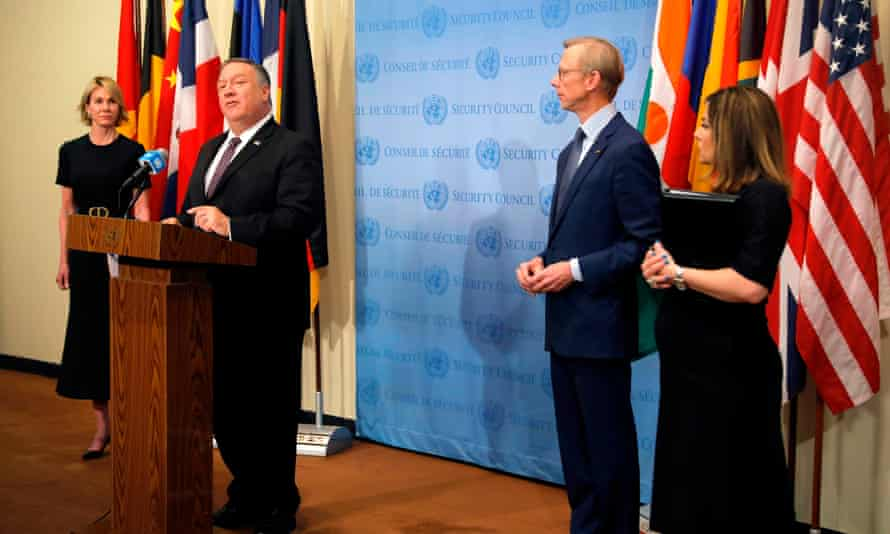 Mike Pompeo is flanked by the US ambassador to the United Nations, Kelly Craft, and US special representative for Iran, Brian Hook, as he speaks to reporters following a meeting with members of the UN security council.