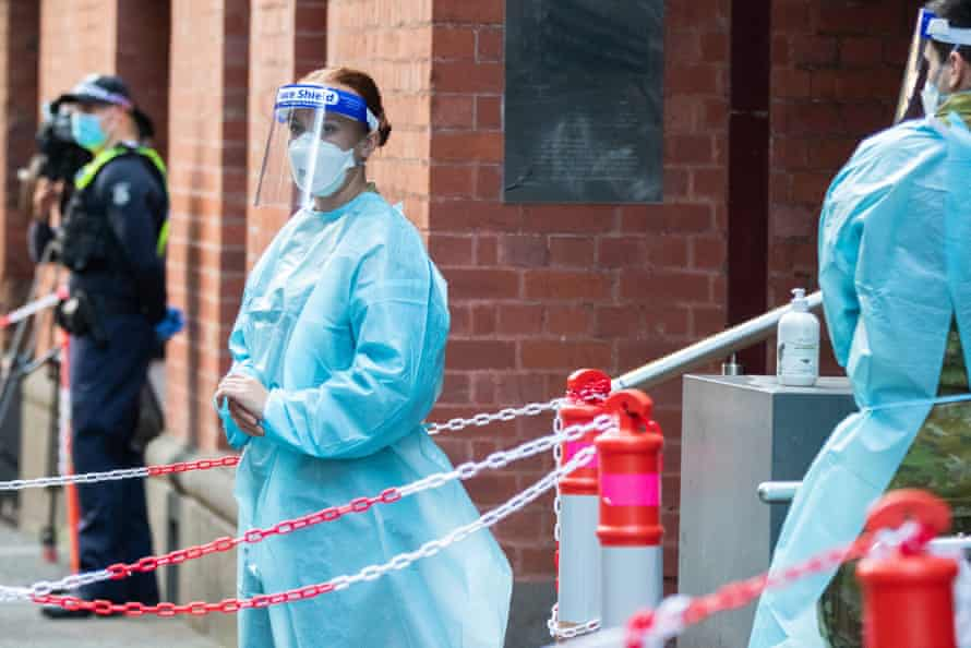 Hotel quarantine workers in PPE are seen outside the Intercontinental Hotel in Melbourne in April.