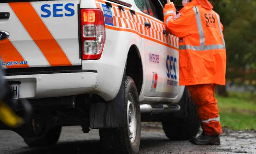 An SES vehicle and crew member