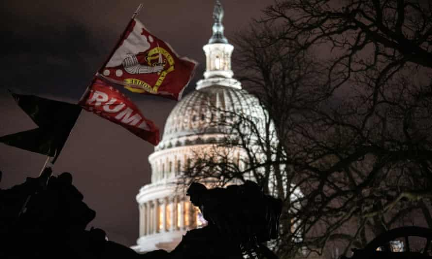 A Trump flag flies over the grounds of the US Capitol after a pro-Trump mob stormed the building earlier, breaking windows and clashing with police officers.