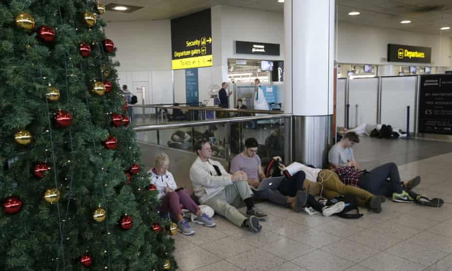 Grounded passengers wait near the departures gate at Gatwick airport on 20 December 2018.