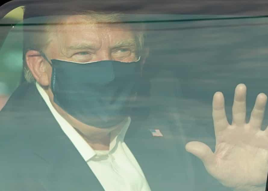 Trump waves to supporters after being taken to Walter Reed with coronavirus.