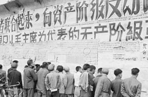 Chinese citizens on 1 November, 1967, view writings and slogans emblazoned on a wall at the height of the Cultural Revolution