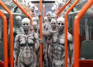 Models turned into 'humanoid' robots pose on a train at Waterloo station for the launch of new Sky Atlantic TV drama Westworld