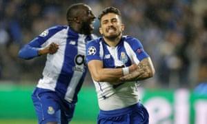 Alex Telles celebrates scoring the decisive penalty for Porto.