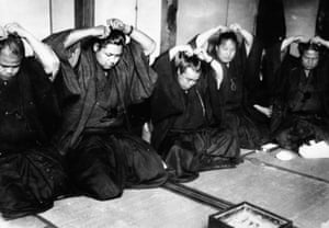 Japanese sumo wrestlers, or rikishi, cutting their traditional bun in protest at their their low pay in February 1932