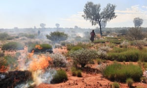 Aboriginal rangers and traditional owners conduct fire management burns in the Katiti-Petermann Indigenous protected area
