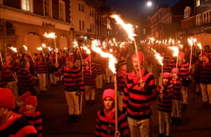 Participants carrying torches march during the traditional Bonfire Celebrations
