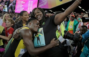 McLeod celebrates victory with his mother who is wearing a t-shirt bearing his picture.