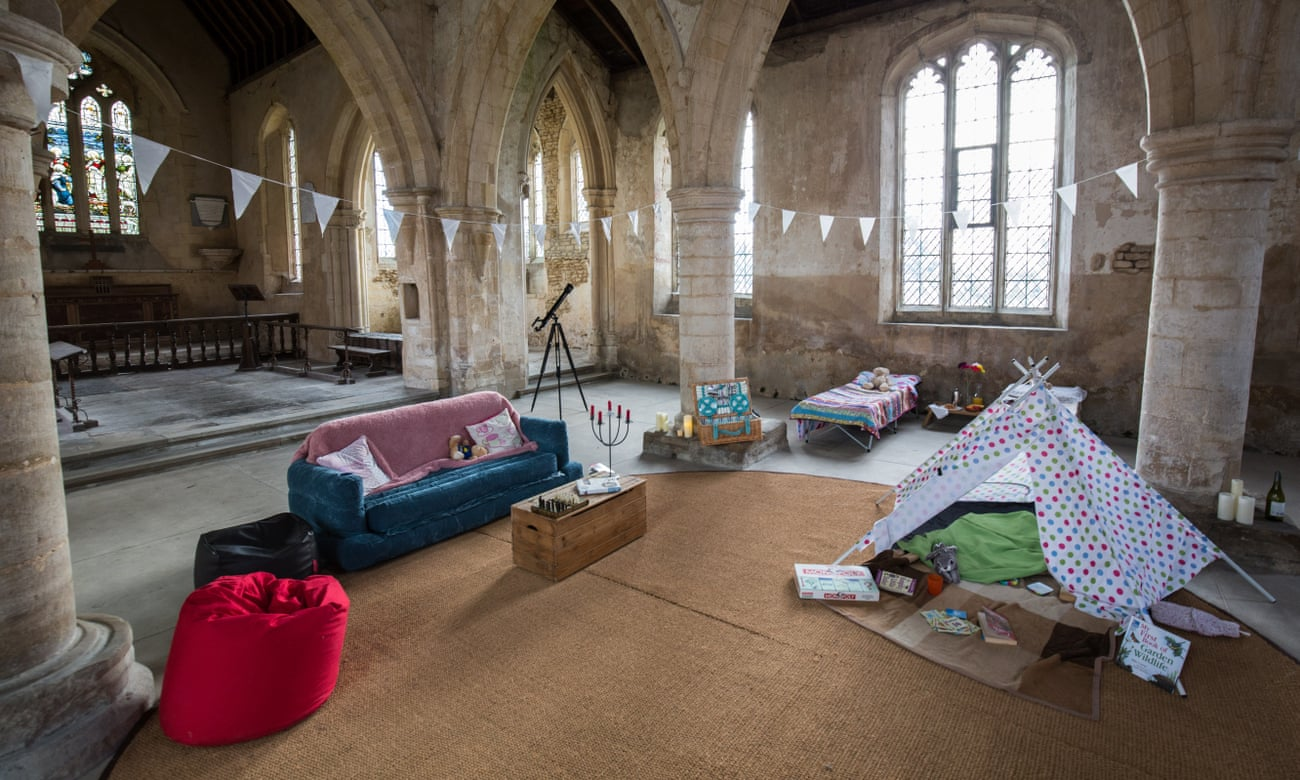 'Champing' at All Saints, Aldwincle, Northamptonshire, beds made up on the floor, sunlight streaming through the windows.