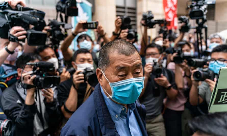 Hong Kong media tycoon Jimmy Lai arrives at the West Kowloon magistrates court
