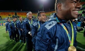 Fiji's sevens players celebrate their 43-7 victory over Great Britain with a conga.
