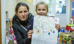 Olga Rebrova and her daughter at the Save the Children community centre in Avdiivka.