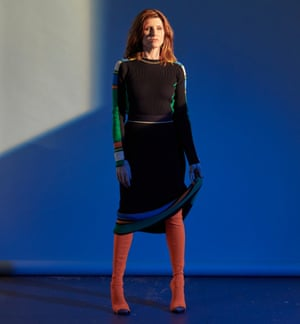 Sharon Horgan in a black dress and russet  boots