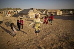 Ten-year-old Zubaida Faisal, a Syrian refugee, skips at an informal settlement