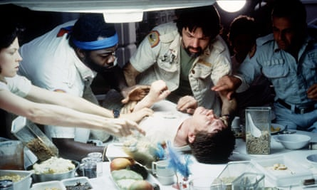 About to burst ... John Hurt (centre) in the iconic scene from Alien.