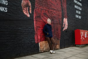 Journalist, scouser and lifelong Liverpool F.C. fan, Hannah Jane Parkinson, photographed outside Anfield in front of a mural of Liverpool player and Liverpool lad, Trent Alexander-Arnold