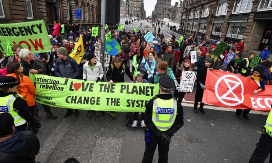 Extinction Rebellion protesters blockade North Bridge in Edinburgh.