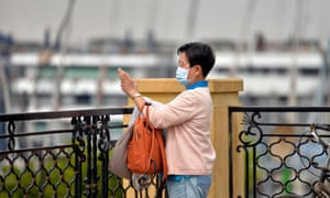 A tourist takes photos of cruise ships docked in Luxor, after authorities conducted coronavirus screening on visitors.