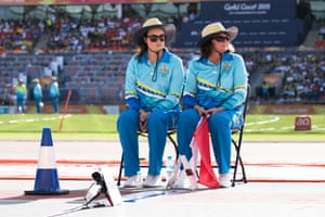 Volunteers sitting next to the long jump pit