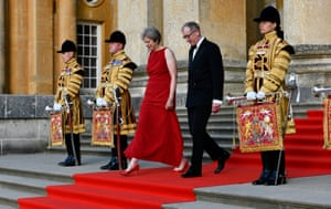 Theresa and Philip May walk down the red carpet to greet the Trumps at Blenheim Palace