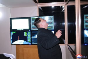 North Korean leader Kim Jong-un is photographed as the newly-developed intercontinental ballistic rocket Hwasong-15 is successfully test launched.
