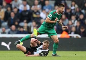 Newcastle's Sean Longstaff fouls Wolves' Ruben Neves.