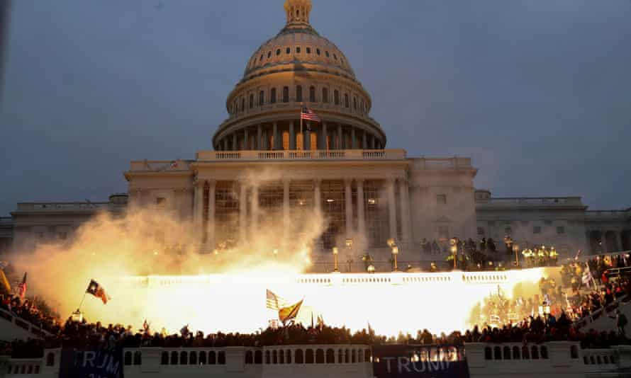 An explosion is caused by a police munition as Trump supporters surround the Capitol in Washington on 6 January.
