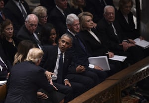 Donald Trump shakes hands with former US president Barack Obama, as Michelle Obama, Bill and Hillary Clinton and Jimmy and Rosalynn Carter attend the state funeral of George H W Bush at the Washington National Cathedral.