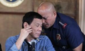 Duterte and police chief Ronald Dela Rosa (right) in Manila.