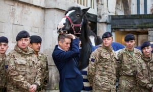 Gavin Williamson with members of the Household Cavalry in central London.