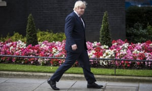 Boris Johnson leaves Downing Street after being appointed foreign secretary.