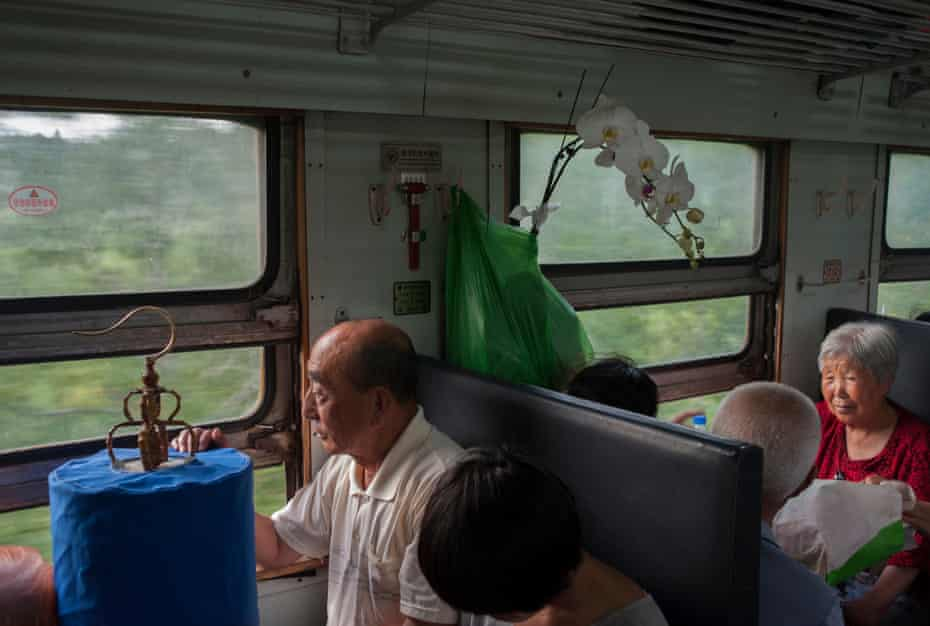 A main stares of a train window in an image from The Green Train